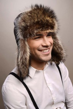 Brown mens fur hat, fashioned from nappa lamb leather, combined with natural raccoon fur, material that is used for the lining