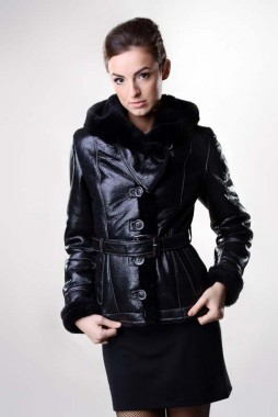 Womens fur coat, made from natural sheep fur, with the exterior manufactured from nappa sheepskin, processed sheepskin, moisture and dirt resistant.