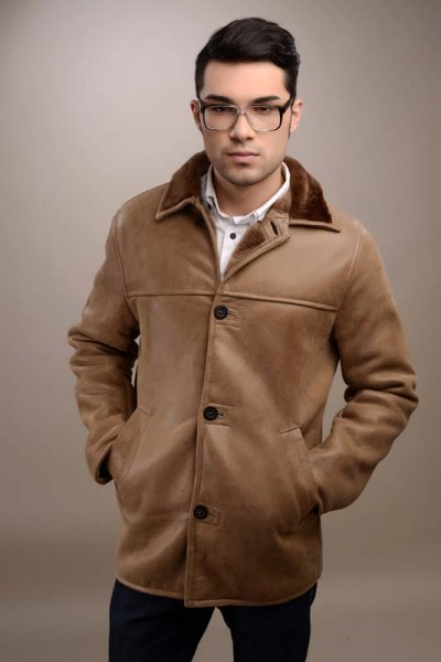 Elegant fur coat, made from natural sheepskin and real fur